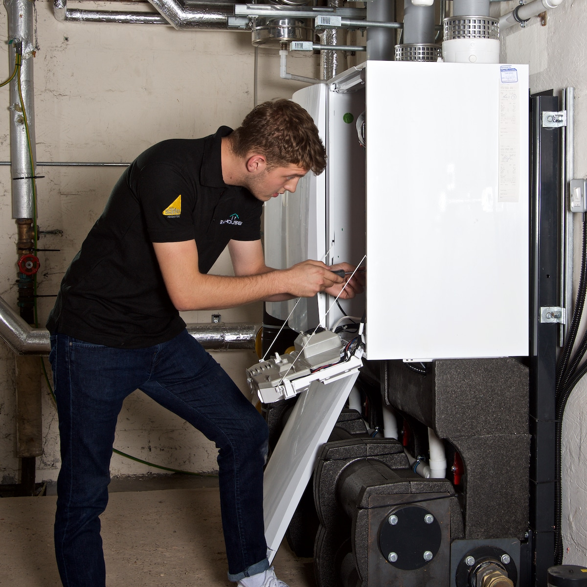 gas fitter working on a boiler